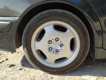 шины бур16 в Кыргызстан: Меняю свои диски с резиной стоят зимние шины, протектор 90% размер/20