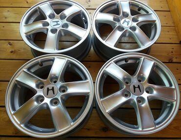 Оригинальные R15 диски Honda (3) Комплект оригинальных литых дисков на