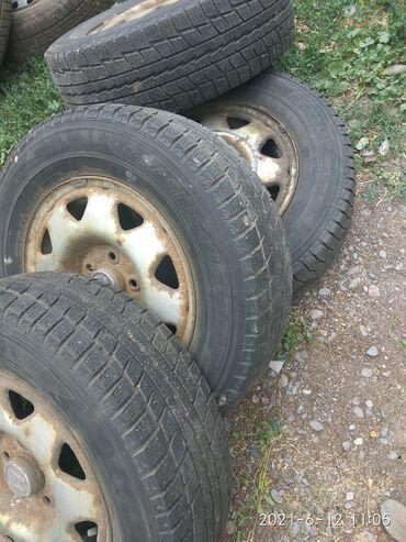 205.70.R15.Шины с дисками.(зима)Одной фирмы Dunlop Остаток протектора