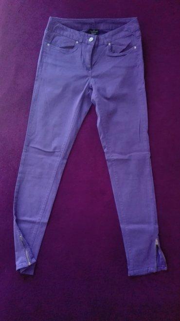 Pantalone flame moderno - Srbija: Prodajem Flame ljubicaste pantalone 38 velicina. Poluobim struka 35cm