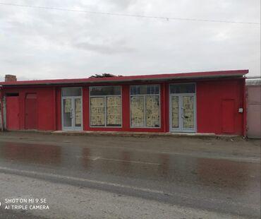 Balaxanıda yol kənarında sahəsi 96kv-m, ayrıca anbarı, tualeti olan ta