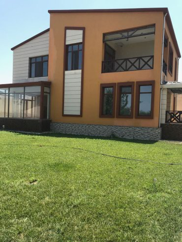 Bakı şəhərində Novxanıda 16 sotda modern lahiyəli 2 mərtəbəli 7 otaqlı bağ evi
