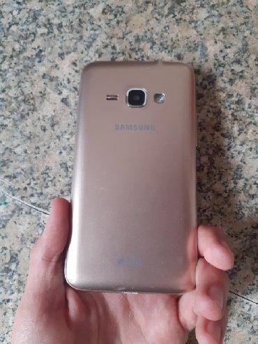 Samsung galaxy j1 - Азербайджан: Б/у Samsung Galaxy J1 8 ГБ Золотой