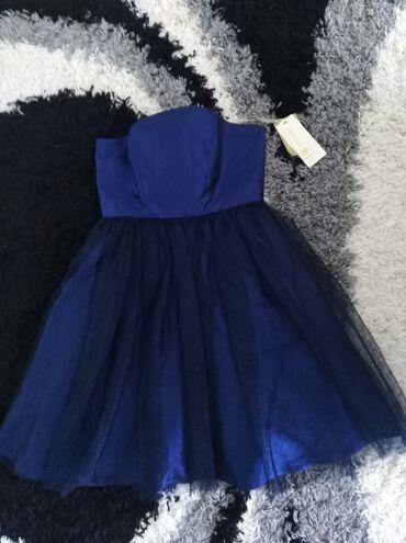 587 oglasa: Potpuno nova haljina, sa etiketom, vel S/M. Na grudima ima ojačanje, n