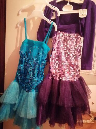 Dečija odeća i obuća - Gornji Milanovac: Dve haljinice u različitim bojama. Jedna tirkiz plava, druga