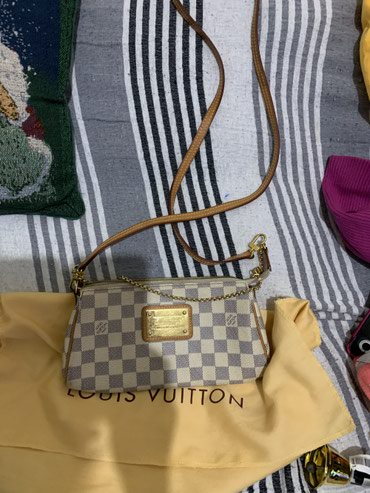 Authentic louis vuitton eva clutch with leather strap σε Agii Anargyri
