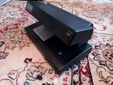 Аппарат для проверки подленности денежных купюр с ультрафиолетом