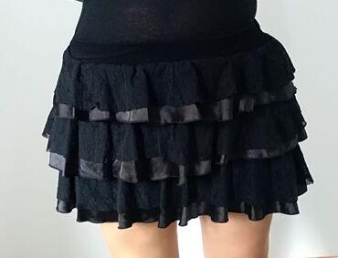 Lepa leprsava suknjica sa karnericima, nikad nosena, prelepo stoji