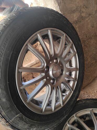 купить диски для машины в Кыргызстан: Новые шины с титановыми дисками. В городе Каракол. 4шт. Зимние. Купили