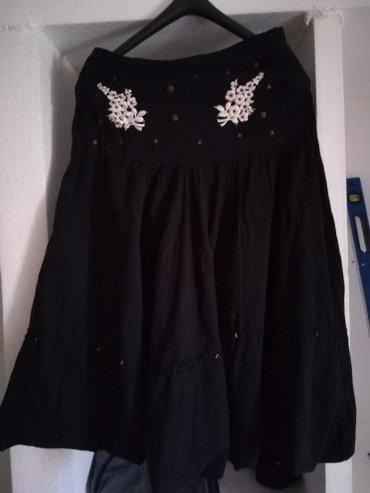 Crna suknja koja moze da se nosi i kao top haljinica. - Nis