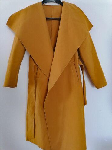 Prodajem kaput nov i nenošen, oker boje, velicina je univerzalna