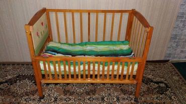 Детская кроватка-манеж