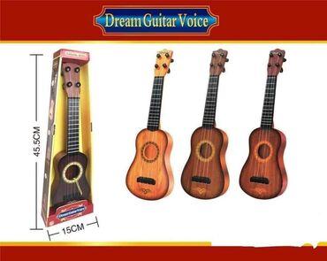 Gitara sa trzalicom  Dimenzije: 45,5x15x5,5cm  Cena 1.500 dinara