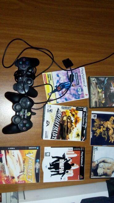 Sony PS 2  Iki ədəd pult  Oyun kartı  15 ədəd diski