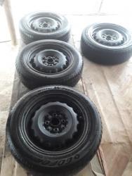 железные диски r14 в Кыргызстан: Продаю железные диски с резиной от Toyota ist . raum .vitz .Honda fit