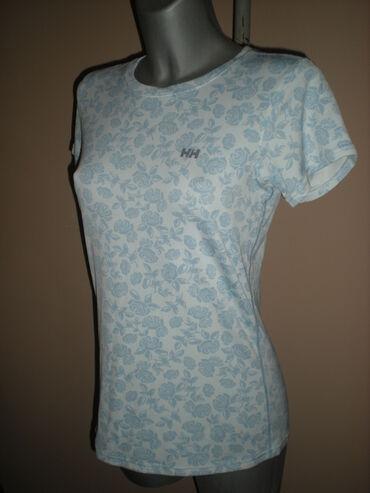 Sivi broj - Srbija: HELLY HANSEN MAJICASportska majica brenda HHU osnovi bele boje, sa