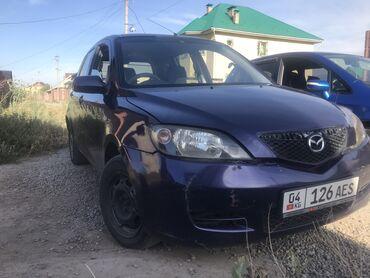 Mazda Demio 1.3 л. 2003