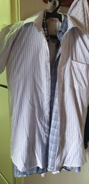 Продаю рубашки мужские 39 42разм. есть и новые и б.у но одет всего 2