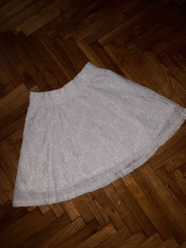 Y.F.K. Bela, cipkana, postavljena suknja, velicina146-152. Lastis u