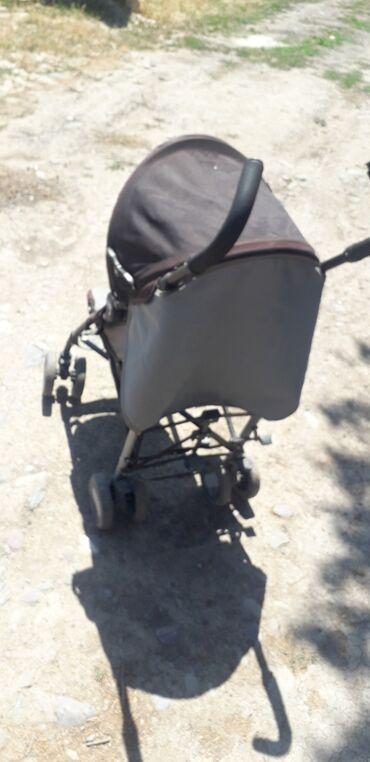 Детский мир - Полтавка: Прогулочная коляска  Состояние хорошая