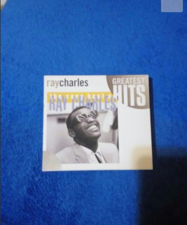 "Nov,nekoriscen cd ray charles ""the very best off"" greatest hits!   ori - Beograd"