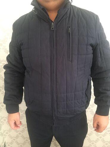 Продаю куртку размер 52 -54, цвет темно синийВ подарок кепка шерстяная