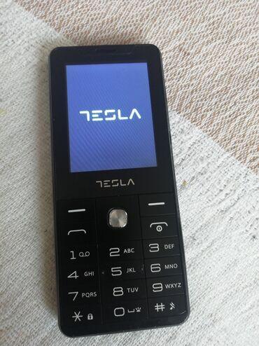 Tesla feature 3.1 dual sim. Dimenzije 124 x 53 x 10.8 mm. Sa dve