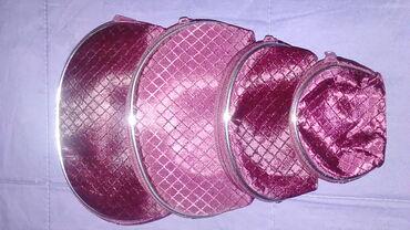 Nov set od 4 torbice-nesesera u bordo boji sa srebrnim ivicama,prelep