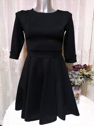 Made in Italy elegantna haljina kao nova. Strukirana.  Boja intenzivno