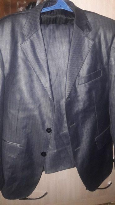 Мужской костюм 48-50 размер примерно на крупного мужчину с небольшим