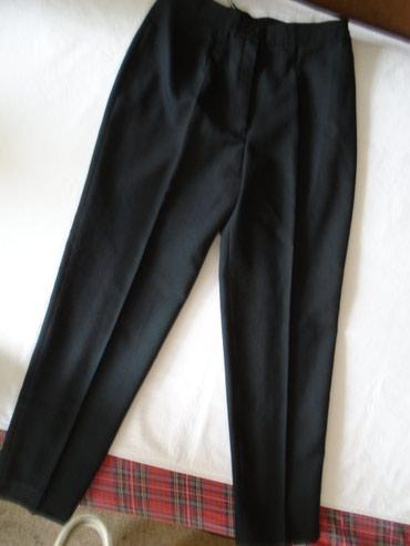 Poslovne pantalone - Srbija: Crne, poslovne pantalone na peglu, lako se kombinuju, očuvane. Imaju
