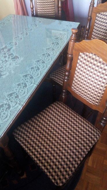 Trpezarijski sto sa 6 stolica puno drvo . kao