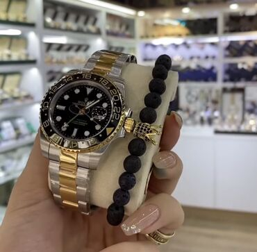 New from box rolex gold original with bracelet.For further information