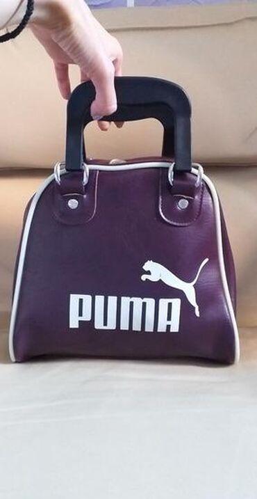 Original Puma torba,srednje velicine, neobicnog oblika sa
