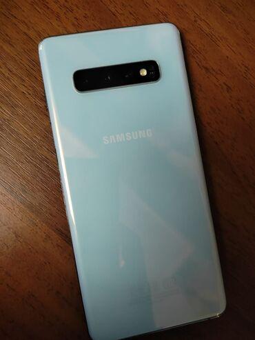 Samsung Galaxy S10 Plus | 128 ГБ | Белый | Гарантия, Отпечаток пальца, Беспроводная зарядка