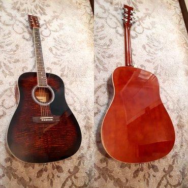 Bakı şəhərində mukemmel akustik gitara teze kimi