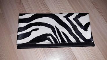 Pismo torbica, spoljašnja strana crno-bela (zebrasta), unutrašnja - Nis