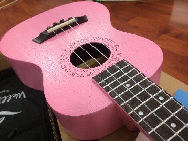 Гитары в Кыргызстан: Розовые укулеле концерт, разная гравировка (рисунок) несколько фирм