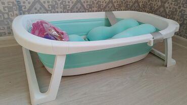 Складная ванночка, предназначенная для детей с рождения. Благодаря
