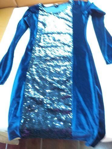 Ženska odeća | Borca: NOVA HALJINA SA SLJOKICAMA od MATERIJALA plis rastegliv materijala