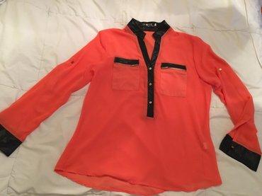 Nova bluza, kupljena u Svajcarskoj. Na njoj pise velicina XL, ali - Uzice