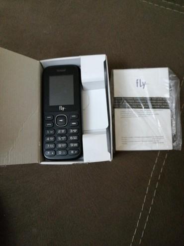 Fly ff188 Telefonun üzərində adaptor və karopka verilir в Хырдалан - фото 2