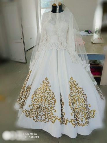 Мусульманское свадебное платье на прокат . Нежного оттенка айвори .Ра