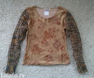 Jako zanimljiva vintage bluzica sa dzemper rukavima. Kupljena u - Novi Sad