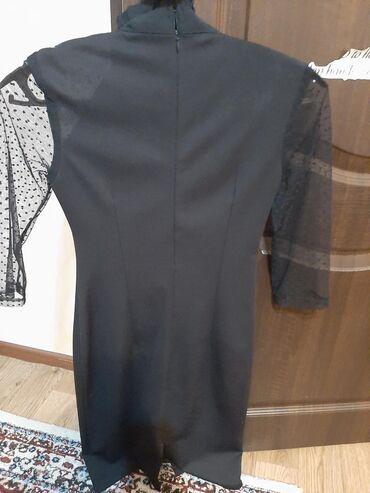 вечернее платье до колен в Кыргызстан: Черное платья в хорошем состояниичуть выше колен . Размер 42-44