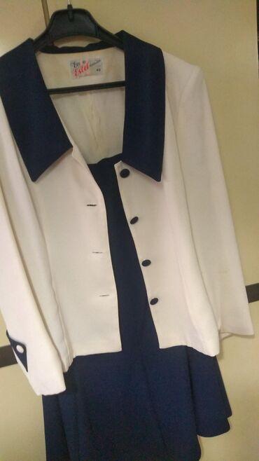 Komplet suknja i bluza. Broj 48 ali odgovara broju 44. suknja je