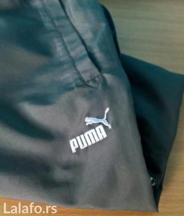 Puma original donji deo trenerke. Veličina l (52-54). Boja je tamno - Belgrade