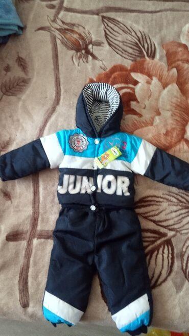 чехол для одежды в Кыргызстан: Продам зимний костюм на мальчика, от 6 мес до года. Высота70 см без