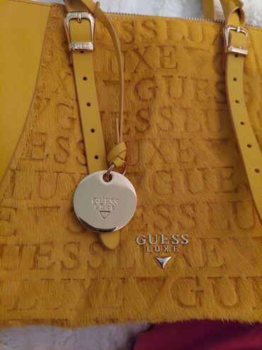 9285 oglasa: Na prodaju Guess luxe torba. U perfektnom stanju,nosena svega par