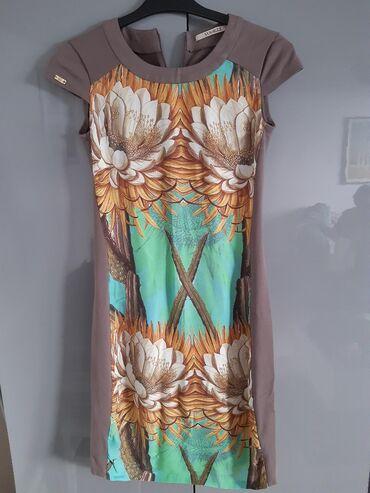 Ženska odeća   Nis: Vogeli haljina velicina 38 ima elastina. Jako atraktivna. Pogledajte i